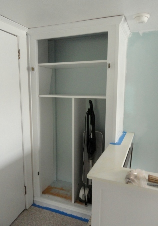 using melamine to re-configure and re-skin the linen closet