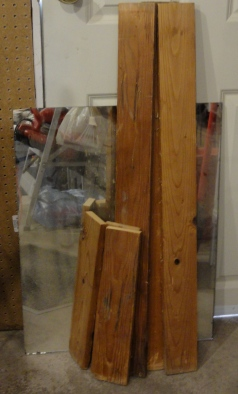 a vintage mirror and some rustic scrap wood--