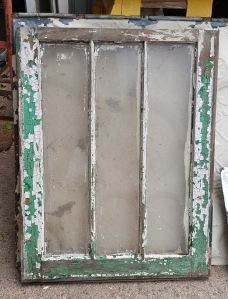 a very petit vintage storm window