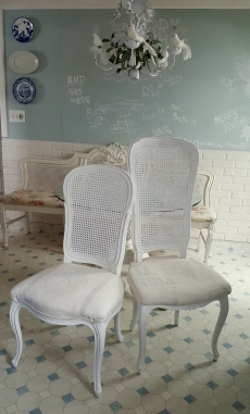 mismatched but similar caned chairs, brought together with paint and grain sacks!