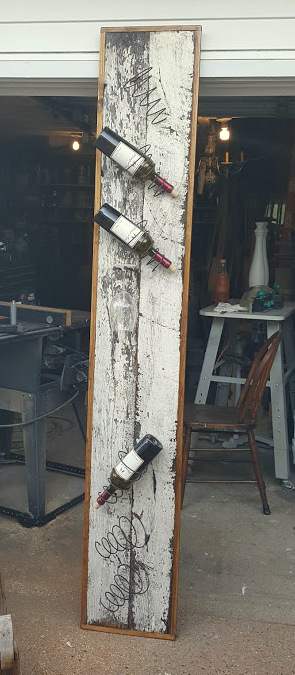 a salvaged wood, farm-styled WINE RACK!