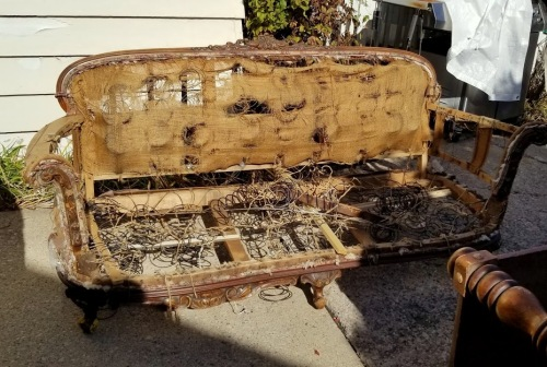 a discarded, original, Victorian sofa